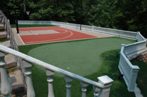 Putting Green beside basketball court