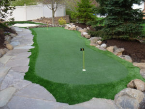 Synthetic artificial turf putting green